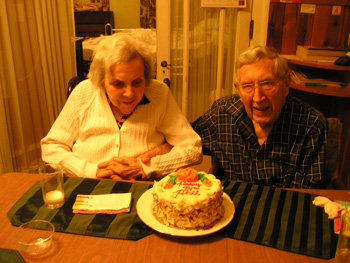 Phil & Thelma in front of Phil's Birthday Cake