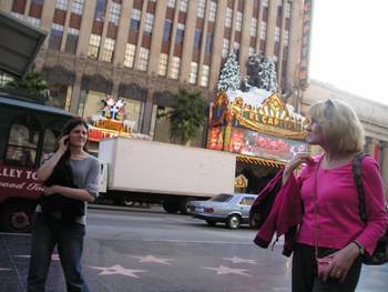 Christina and her Mom walking though Hollywood